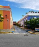 Charming cobblestone street with colonial architecture in San Ju Stock Photos