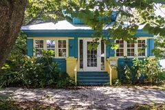 Charming colorful cottage with shaded entry. Charming turn of the century cottage with vibrant colors and shaded entry royalty free stock photography