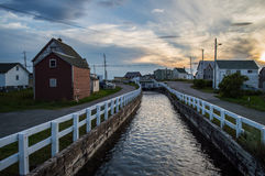 Charming Colorful Houses along a Canal and Sunset in Bonavista, Newfoundland Stock Image