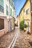 Narrow street between pastel colored buildings stock photo