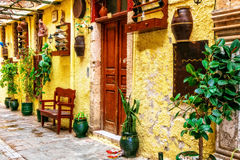 Charming colorful streets of old town in Rethymno, Crete island, Stock Photo