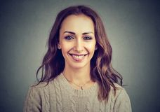 Charming content woman posing at camera royalty free stock image