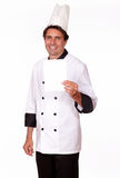 Charming cook holding a blank card of copyspace Stock Image