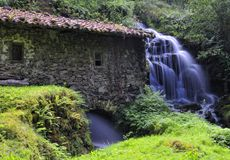 A charming corner. Old water mill with waterfall in Asturias, Spain Royalty Free Stock Photo
