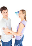 Charming couple arguing choosing color for a room Stock Photography