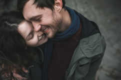 Charming couple in a dress walking down the street Stock Photos