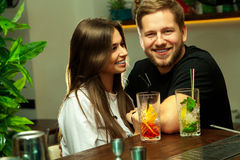 Charming couple having fun in the bar royalty free stock photo