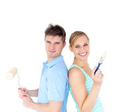 Charming couple smiling at the camera. Against white background Stock Images