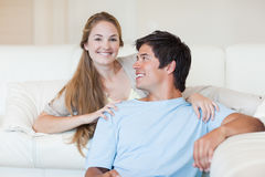Charming couple watching television Stock Image