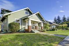 Charming craftsman home with a covered front porch. royalty free stock photography