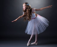Charming curly girl dancing ballet in studio Royalty Free Stock Images