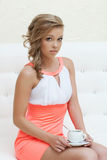 Charming curly girl posing in stylish pink dress Stock Image