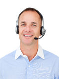 Charming Customer service agent talking on headset. Against a white background Royalty Free Stock Photo