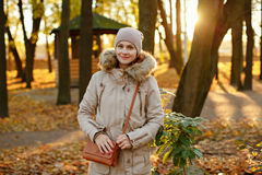 Charming cute and cozy girl in a cap and beige jacket smiling am royalty free stock photo