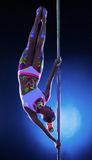 Charming dancer hanging upside down on pylon Stock Photo