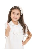Charming dark-haired little girl thrust out his Royalty Free Stock Image