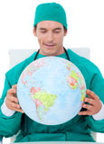 Charming doctor holding terrestrial globe royalty free stock image