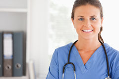 Charming doctor smiling at the camera Royalty Free Stock Image