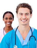 Charming doctors smiling at the camera Royalty Free Stock Photo