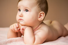 Charming dreamy baby girl Stock Image