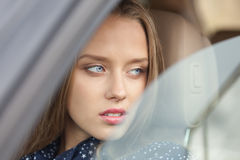Charming driver. Portrait of a charming driver sitting in the car royalty free stock photo