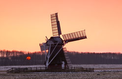 Charming Dutch windmill during sunset. Charming Dutch windmill and sun during sunset Stock Photography