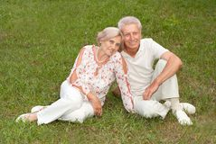 Charming elderly couple went to the nature. Sympothetic elderly couple went to the nature on weekends Stock Photos