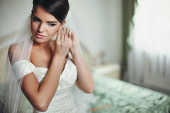 Charming elegant young bride. Wearing expensive jewelry Stock Photography