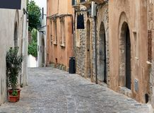 Charming empty cobblestone street of old town of Ibiza Eivissa. Balearic Islands. Spain stock images