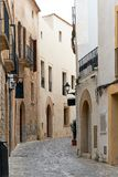 Charming empty cobblestone street of old town of Ibiza Eivissa. Balearic Islands. Spain stock photography