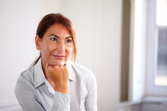 Charming enterpreneur lady smiling and thinking Stock Images
