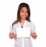 Charming ethnic young woman holding a white card Royalty Free Stock Images