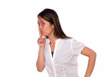 Charming ethnic young woman requesting silence Stock Photos