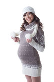 Charming expectant mother posing in warm clothes. Isolated on white royalty free stock photography