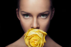 Charming face with rapier glance. yellow rose. stock images