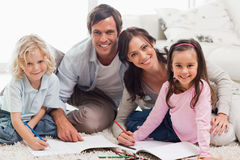 Charming family drawing together Royalty Free Stock Photos