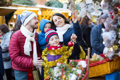 Charming family of four buying holidays decorations Stock Image