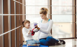 Charming family spends time in the gym Stock Photos