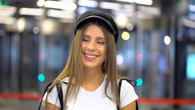 Charming fashion cute young woman looking at camera. Portrait face of caucasian beautiful stylish girl model. Attractive stock footage