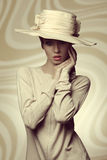 Charming fashion elegant girl. Fashion shoot of sensual female with elegant coordinated style, big hat and beige dress Stock Images