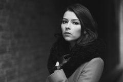Charming fashion female modell in a coat. Royalty Free Stock Photography
