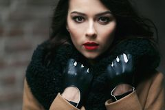 Charming fashion female modell in a coat. Royalty Free Stock Image