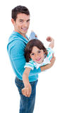 Charming father giving his son piggyback ride Royalty Free Stock Images