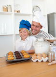 Charming father and his son baking at home Stock Image