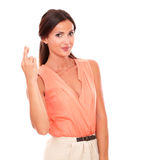 Charming female crossing fingers as luck sign Stock Image