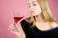 Charming female drinks cocktail Royalty Free Stock Photo
