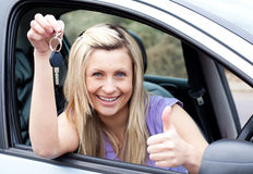 Charming female driver showing a key Stock Images