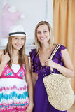 Charming female friends smiling at the camera Royalty Free Stock Photo