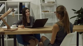 Businesswoman interviewing job applicant in office stock footage