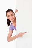 Charming female pointing at a copy space Royalty Free Stock Photo